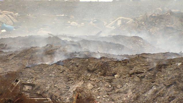 A close-up view of Iqaluit's dump fire on June 26, 2014. The fire has been burning since May 20, forcing schools to close and even smoking out a planned city cleanup. The city is now considering options for putting it out, but the cost is daunting. ( Jane Sponagle-CBC )