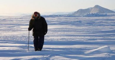 Inuit hunter Elijah Palituk looks for seal breathing holes in the ice off the coast of northeast Baffin Island in Canada