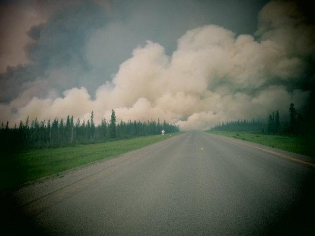 A shot of smoke billowing over Highway 3 between Fort Providence and Rae. (GNWT)