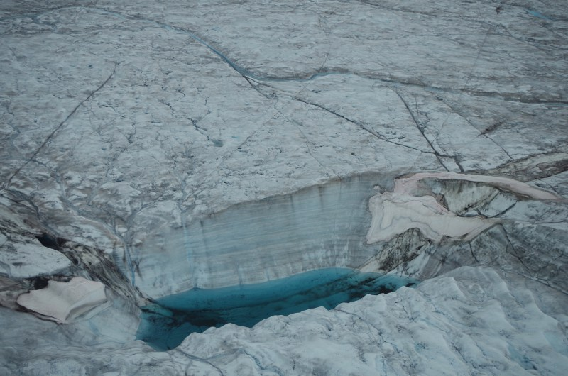 A moulin in a supraglacial lake on the Greenland Ice Sheet. (Mia Bennett / August 2014)