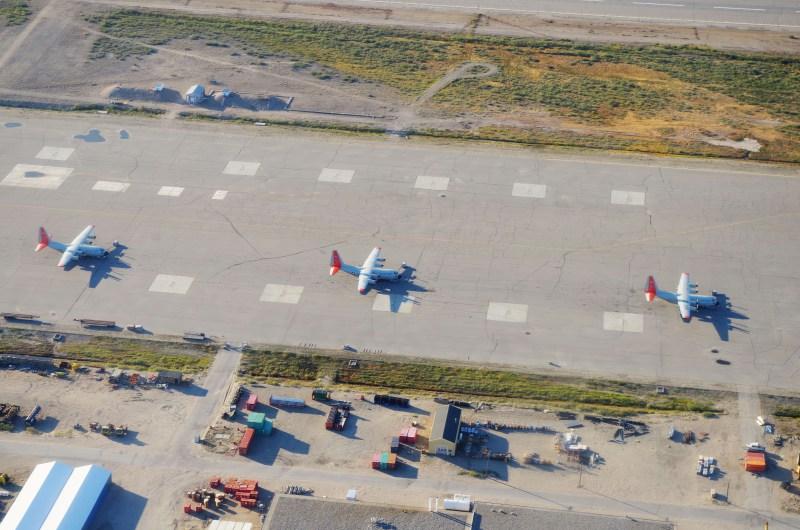 Three U.S. ANG C-130s on the runway in Kangerlussuaq. (Mia Bennett, August 2014)