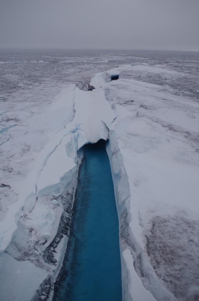 A supraglacial river. (Mia Bennett / August 2014)