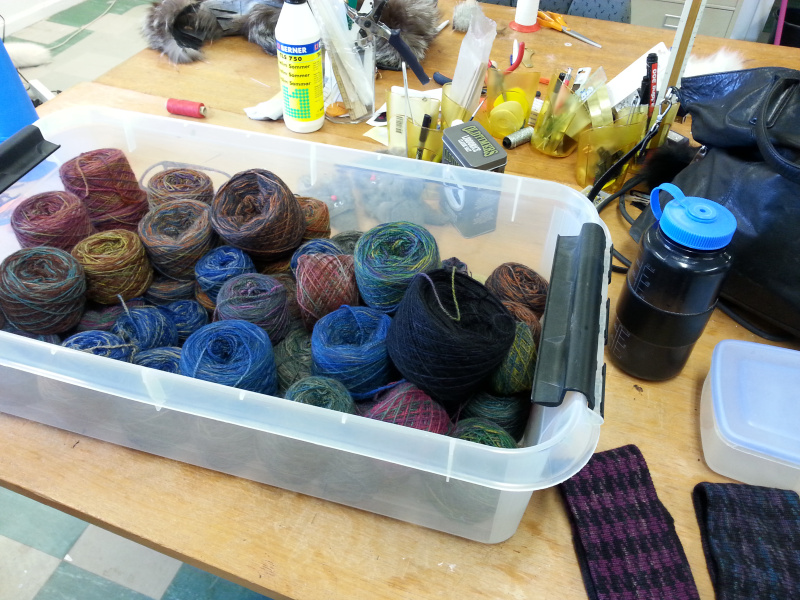 Dyed muskox wool on a workshop table and two headbands in the bottom right.(Mia Bennett/August 2014)