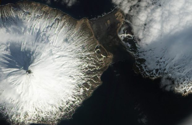 An ash cloud puffs from Mount Cleveland in a March 14, 2013 satellite photo. New equipment installed on the volcano this summer will provide scientists at the Alaska Volcano Observatory with more and better information about its activity.  (NASA)