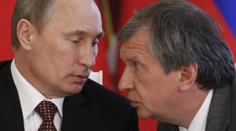 Russian President Vladimir Putin, left, and CEO of state-controlled Russian oil company Rosneft Igor Sechin, at a signing ceremony in 2013. (Maxim Shemetov/ AP)