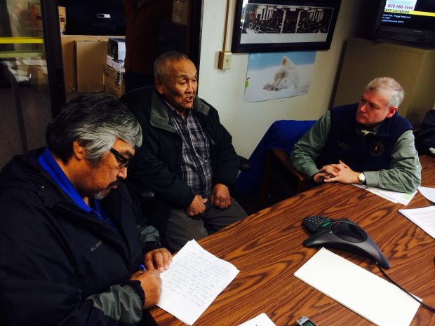 Musher and sobriety activist Mike Williams, left, elder John Phillip and Lt. Gov. Mead Treadwell in Bethel at a town hall meeting on the marijuana legalization initiative on Sept. 29, 2014. (Lisa Demer / Alaska Dispatch News)