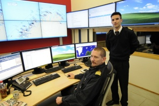 Based in Vardø on the coast of the Barents Sea, Ståle Sveinungsen (right) keeps control of all vessel traffic along the coast of Norway. (Thomas Nilsen / Barents Observer)