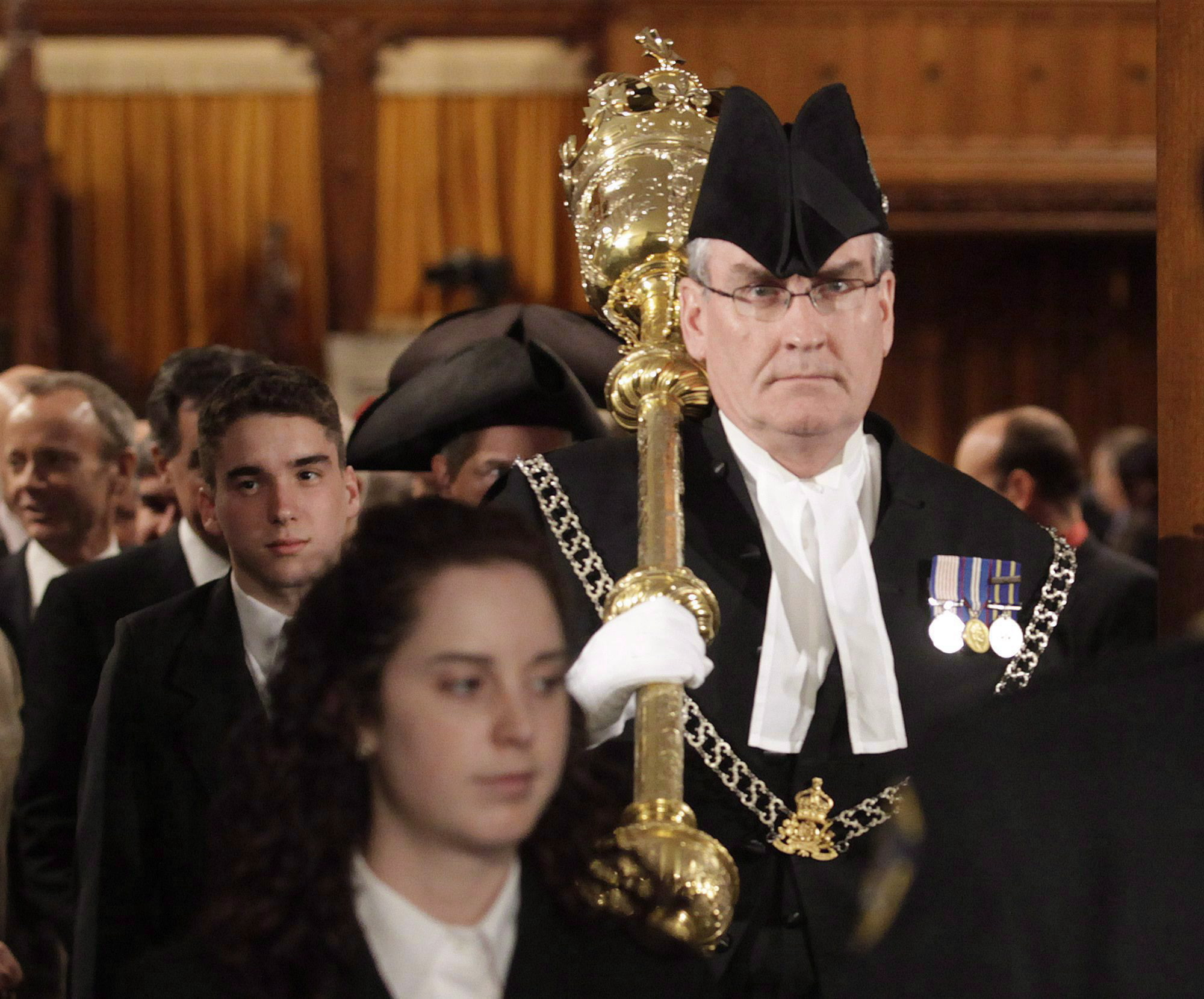 Sergeant-at-arms Kevin Vickers of the House of Commons leads MPs out of the House of Commons on Parliament Hill in Ottawa on Wednesday, March 3, 2010. Two sources told The Canadian Press that Vickers shot an assailant on Parliament Hill on Wednesday. (Pawel Dwulit / The Canadian Press)