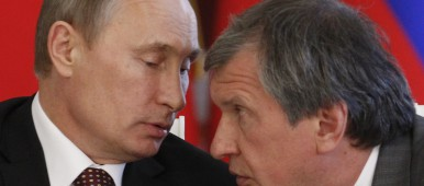 Russia's President Vladimir Putin (L) talks to Rosneft President and Chairman of the Management Board Igor Sechin in 2011. Igor Sechin and his Rosneft might have to wait long before he can launch new projects in Arctic waters. (Maxim Shemetov / AFP / Getty Images)