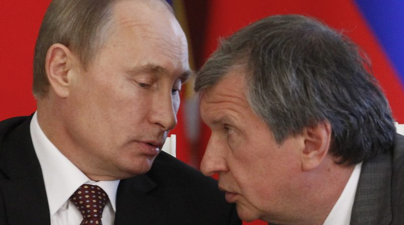 Russia's President Vladimir Putin (L) talks to Rosneft President and Chairman of the Management Board Igor Sechin in 2011. (Maxim Shemetov / AFP / Getty Images)