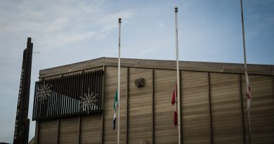 Flags in front of the main Yukon Government Building and Yukon Legislative Assembly in Whitehorse flew at half-mast on Wednesday after the Ottawa attack. (Yukon Government)