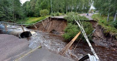 A rain-swollen river washed away the road and felled trees in Kristinehamn, western Sweden, on August 22, 2014. (Johan Nilsson/AFP/Getty Images)