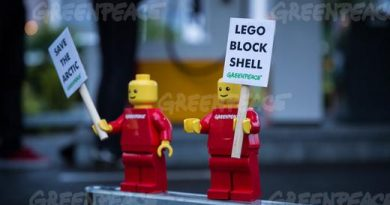 """Greenpeace placed mini activist LEGO figures at a Shell gas station in Legoland in Billund, Denmark with banners reading """"Save the Arctic Stop Shell"""". The action was part of a global campaign to pressure Lego to sever its business partnership with Shell. (Uffe Weng / Greenpeace)"""