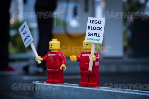 "Greenpeace placed mini activist LEGO figures at a Shell gas station in Legoland in Billund, Denmark with banners reading ""Save the Arctic Stop Shell"". The action was part of a global campaign to pressure Lego to sever its business partnership with Shell. (Uffe Weng / Greenpeace)"