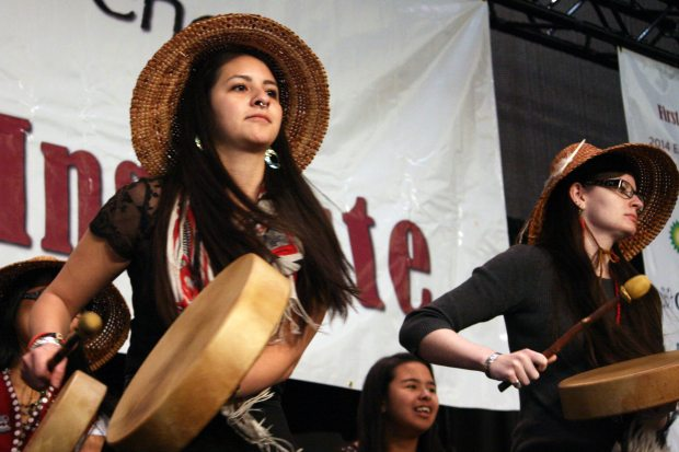 Jill Kaasteen Meserve, 23, of Juneau, performs with the Woosh.ji.een Dance and Drum Group at the First Alaskans Institute Elders and Youth Conference on Wednesday. Meserve said she supported a bill passed this year recognizing 20 Alaska Native languages as official state languages. (Lisa Demer / Alaska Dispatch News)