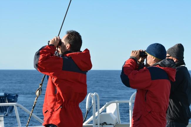 Head of Norwegian Polar institute Jan-Gunnar Winther (left) and head of Polar Institute's centre for Ice Harald Steen (right) looking for ice in the Kara Strait in 2013. (Thomas Nilsen / Barents Observer)