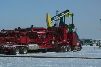 Most of the pumps used for fracking are driven to the wells with huge trucks. (Thomas Nilsen/Barents Observer)