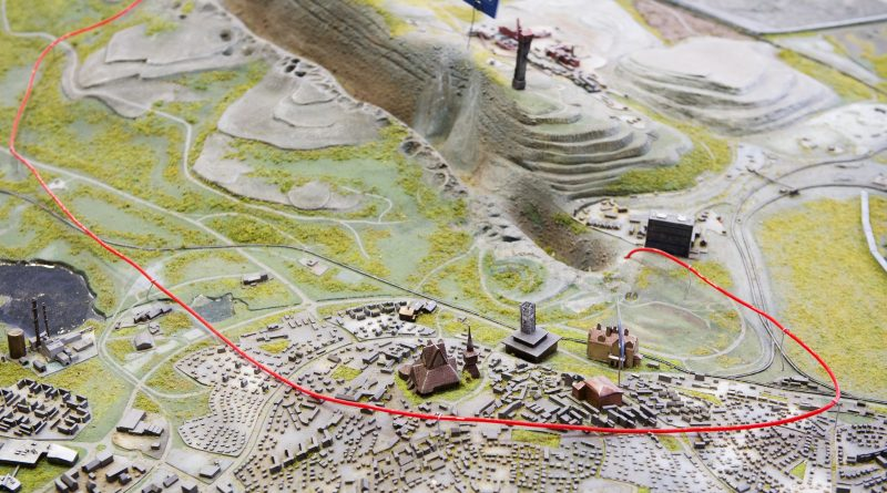 This picture shows a red wire on a model of Sweden's northernmost town of Kiruna that marks the area of the town which will be moved few kilometers away to save it from sinking into the ground due to underground cracks created by iron ore mining. (Jonathan Nackstrand/AFP/Getty Images)