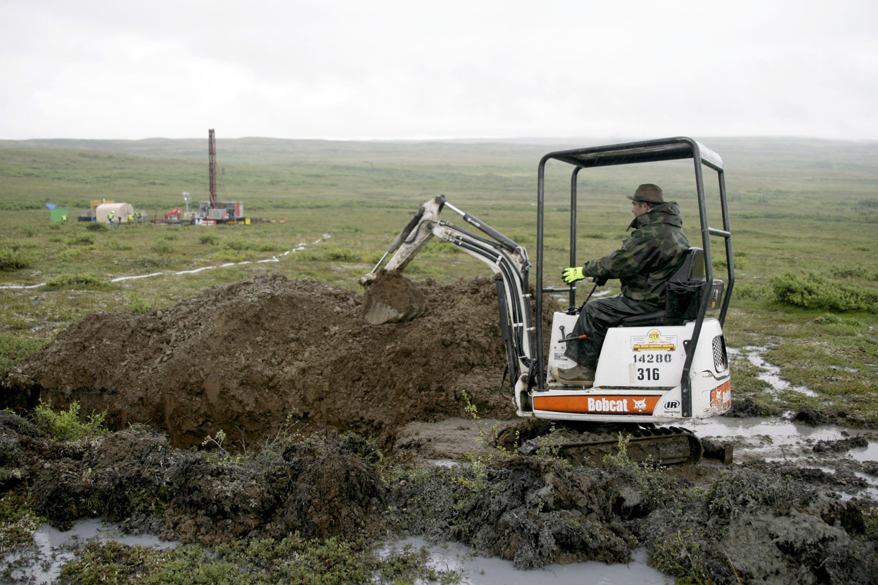 A worker with the Pebble Mine project test drills in the Bristol Bay region of Alaska near the village of Iliamma, Alaska in July 13, 2007. An EPA report at the time indicated a large-scale copper and gold mine in Alaska's Bristol Bay region could have devastating effects on the world's largest sockeye salmon fishery and adversely affect Alaska Natives, whose culture is built around salmon.(Al Grillo/AP)