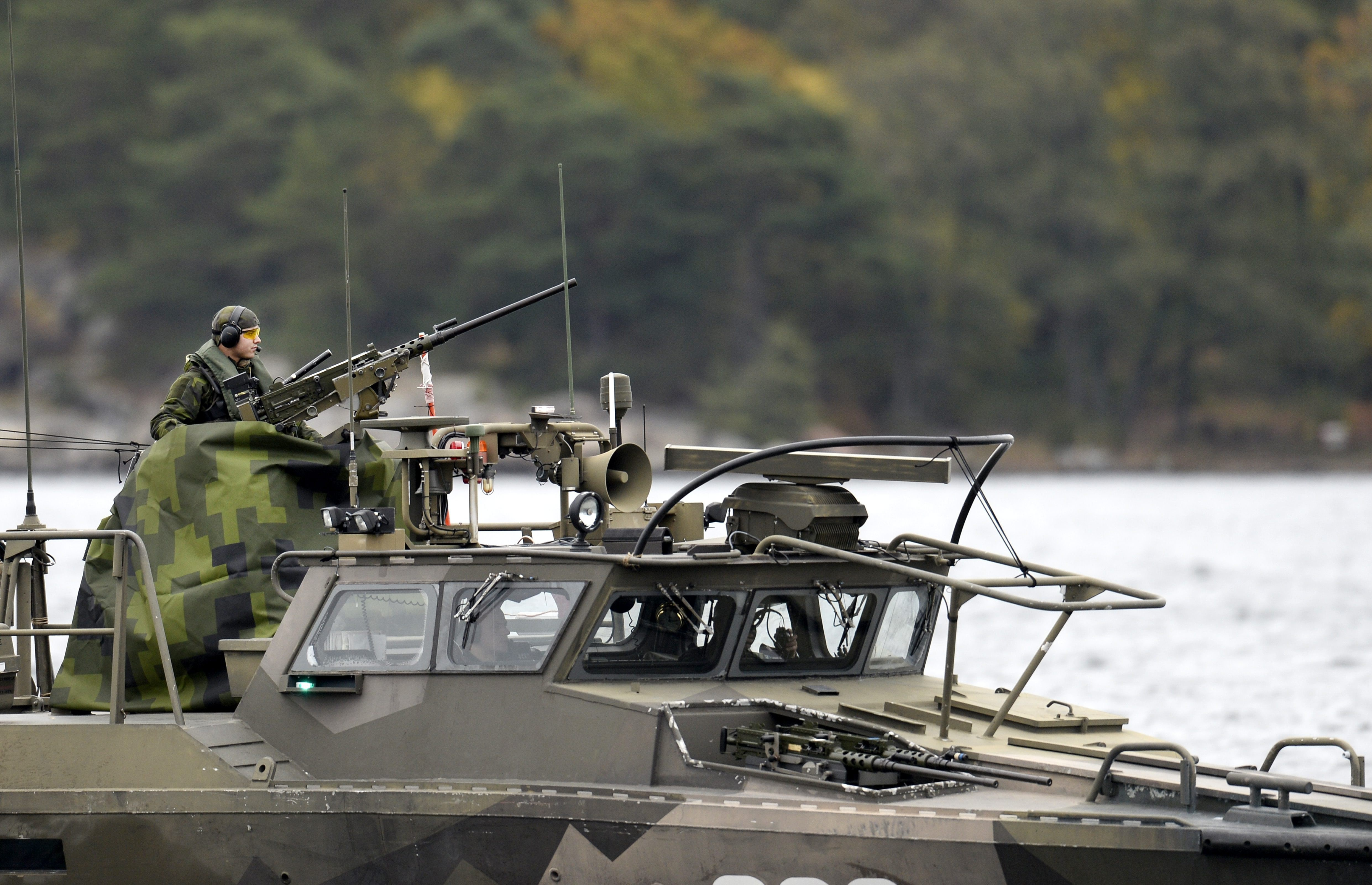 A Swedish Navy fast-attack craft patrols in the the Stockholm Archipelago, Sweden, on October 18 2014. The Swedish armed forces launched a military operation around the islands off Stockholm following reports of suspicious 'foreign underwater activity'. Analysis of this event was one of the top stories on Eye on the Arctic this week. (Pontus Lundahl/AFP/Getty Images)