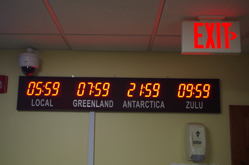 The clocks as they look at the 109th Airlift Wing in New York, from where C-130 planes support U.S. operations in Greenland and Antarctica. (Mia Bennett, 2014)