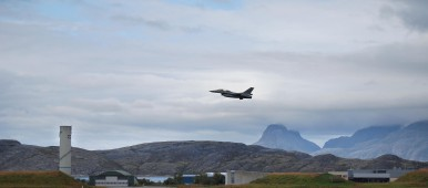 A Norwegian F16 in the air at the aircraft base in Bodoe, northern Norway on August 21, 2008. At the base, situated above the Arctic Circle, two F16s are permanently mobilized ready to scramble within 15 minutes to encounter a potential threat. (Pierre-Henry Deshayes/AFP/Getty Images)