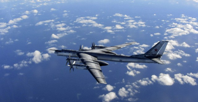 This is a Wednesday, Oct. 29, 2014 file photo provided by Britain's Royal Air Force of a Russian military long range bomber aircraft photographed by an intercepting RAF quick reaction Typhoon (QRA) as it flies in international airspace. (Royal AIr Force/AP)