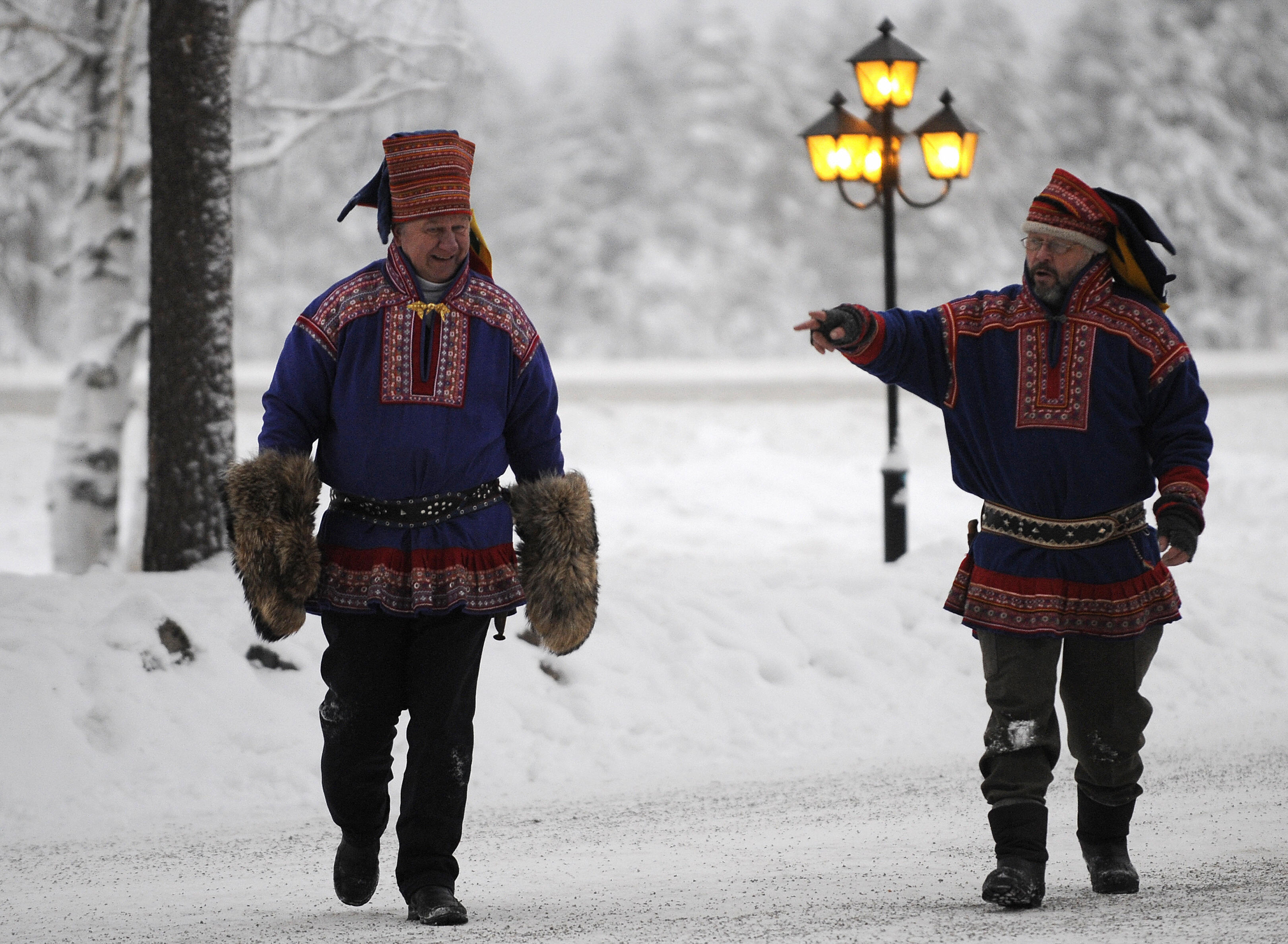 To men in traditional Sami dress in Arctic Finland. A new smart phone app provides a Sami character keyboard. (Olivier Morin/AFP/Getty Images)