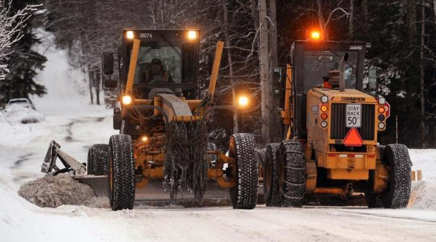 Snowplows work their way up and down East 24th Avenue just off Boniface Parkway in Anchorage in this file photo. ERIK HILL / Anchorage Daily News