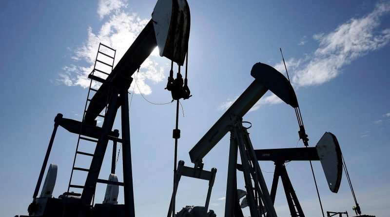 Pumpjacks at work pumping crude oil near Halkirk, Alta., June 20, 2007. (Larry MacDougal/The Canadian Press)