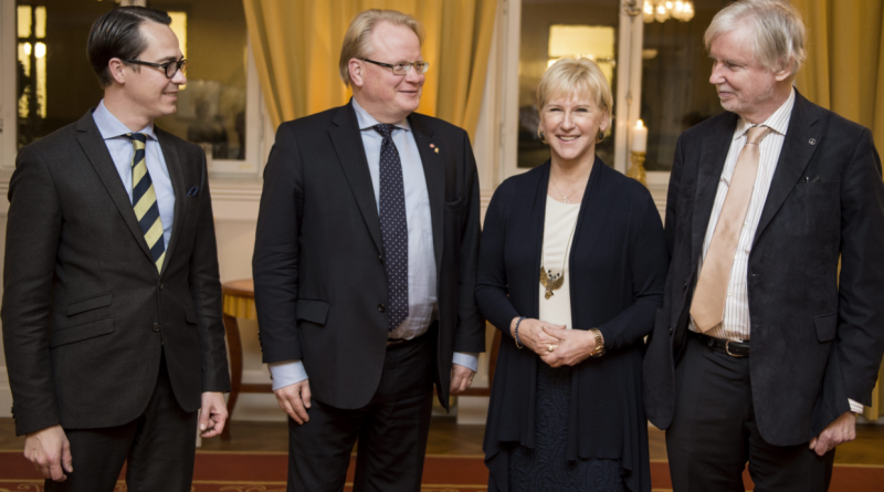 (L-R) Finland's Defence Minister Carl Haglund, Sweden's counterpart Peter Hultqvist, Swedish Foreign Minister Margot Wallstrom and Finnish counterpart Erkki Tuomioja pose for a photo upon arrival for a dinner at the government headquarters Rosenbad, in Stockholm, Sweden, on November 10, 2014. (Pontus Lundahl/AFP/Getty Images)