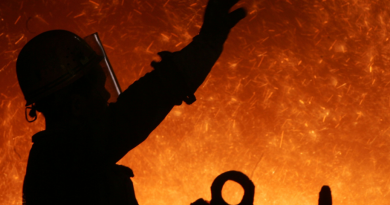 A worker in front of a blast furnace at an iron and steel factory in China. (China Photos/Getty Images)