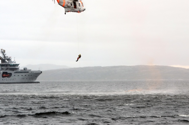 "Exercise Barents includes search and rescue operations. Photo shows ""KV Harstad"" and a Norwegian rescue helicopter involved in a similar exercise in 2013. (Jonas Karlsbakk/Barents Observer)"
