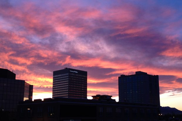 (A sunrise over downtown Anchorage on Thursday morning, Nov. 13, 2014, as seen from the top of the Hotel Captain Cook parking garage. Erik Hill / ADN)