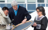 United States Secretary of State John Kerry, centre, and Leona Aglukkaq, Canadian Minister for the Arctic Council, right, chat with a traditional Inuit drummer while attending the Arctic Council Ministerial meeting Friday, April 24, 2015 in Iqaluit, Nunavut. (Paul Chiasson/The Canadian Press)