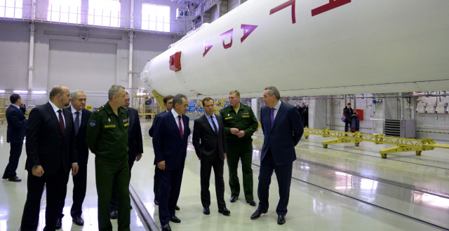 In this Wednesday, Feb. 19, 2014 file photo, Russian Prime Minister Dmitry Medvedev, third right, visits an assembly shop, with the Angara booster rocket at right, at the Plesetsk Cosmodrome in Plesetsk, northwestern Russia. The recent Angara A5 rocket launch failed and crashed near a near the village of Zabolotye in Arkhangelsk Oblast. (Alexander Astafyev/ Government Press Service/RIA-Novost/AP)