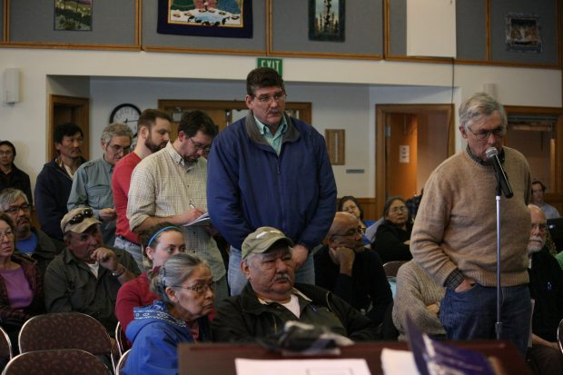 Dozens of Bethel residents and people from nearby villages packed the Yupiit Piciryarait Cultural Center on Monday evening for a town hall meeting on the prospect of a liquor store in Bethel. Longtime resident Bob Carlson, at microphone, was the first of residents and community leaders who lined up to ask questions of Cynthia Franklin, ABC Board director. (Lisa Demer / Alaska Dispatch News)