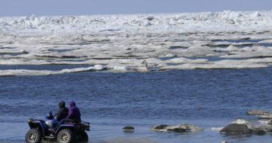 ATV riders travel the Chukchi Sea beach in Barrow on Monday, June 27, 2011. (Marc Lester / Alaska Dispatch News)