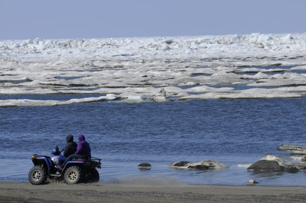 ATV riders travel the Chukchi Sea beach in Barrow on Monday, June 27, 2011. (Marc Lester / Alaska Dispatch News)