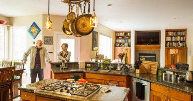Couple Ron Clarke and Kristine Kennedy in their west Anchorage home. (Loren Holmes / Alaska Dispatch News)