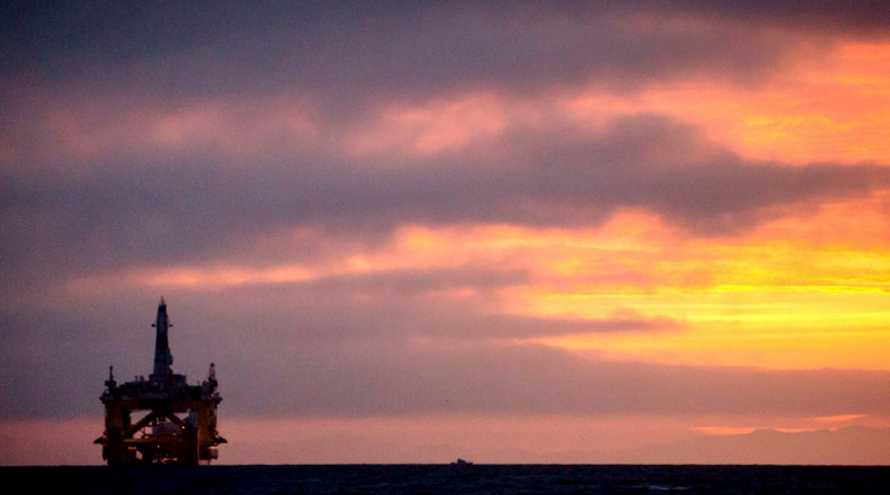 In this April 17, 2015 file photo, an oil drilling rig arrives aboard a transport ship at sunrise, following a journey across the Pacific in Port Angeles, Wash. Royal Dutch Shell hopes to use the rig for exploratory drilling during the summer open-water season in the Chukchi Sea off Alaska's northwest coast. (Daniella Beccaria/seattlepi.com via AP)