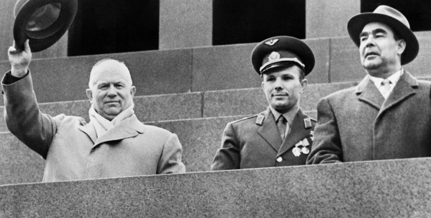 Soviet Cosmonaut Yuri Gagarin (centre), Soviet leader Nikita Khrushchev (left) and Leonid Brezhnev (right) salute the crowd on May 1, 1961 during a gathering on Red Square to celebrate Gagarin's flight aboard Vostok I. Yuri Gagarin became the first human to travel in space aboard Vostok I and the first to orbit the Earth. For decades, the U.S. and the Soviet Union battled to outdo each other in space. Any echoes in today's Arctic? /AFP/GettyImages)