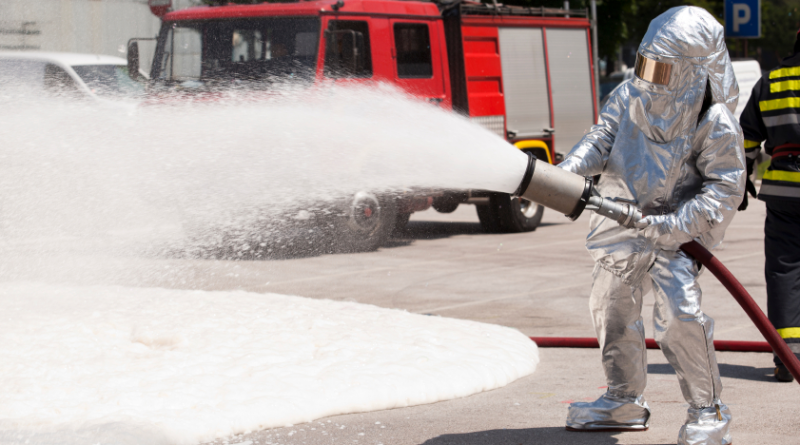 A firefighter in training with fire retardant foam. What effect does foam have on the environment? (iStock)