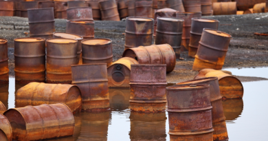 Rusty fuel and chemical drums on the Arctic coast. (iStock)