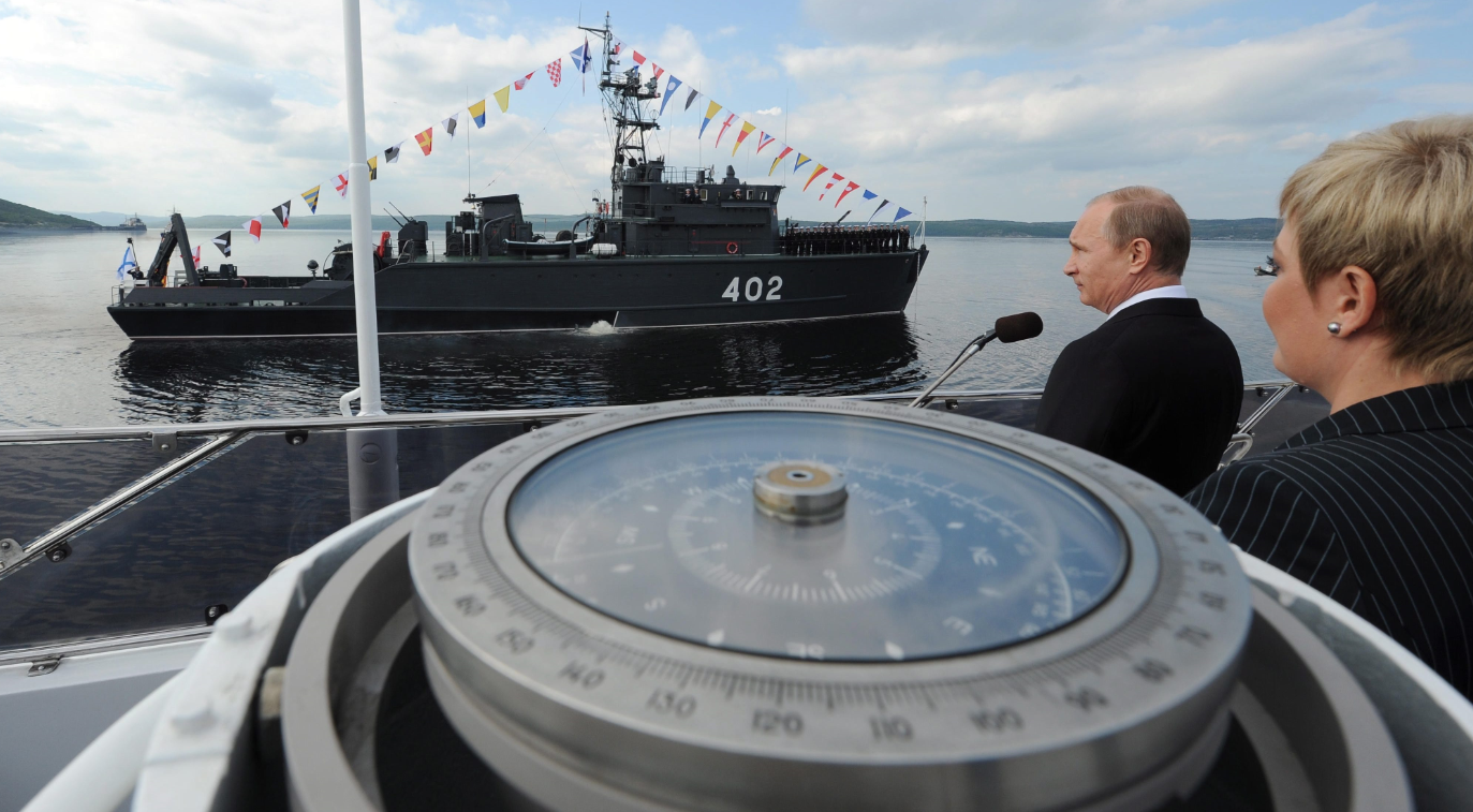 Russian President Vladimir Putin congratulates the crew of the Northern Fleet ship to mark the country's Navy Day in Severomorsk, Russia on Sunday, July 27, 2014. (Mikhail Klimentyev/Presidential Press Service/AP)