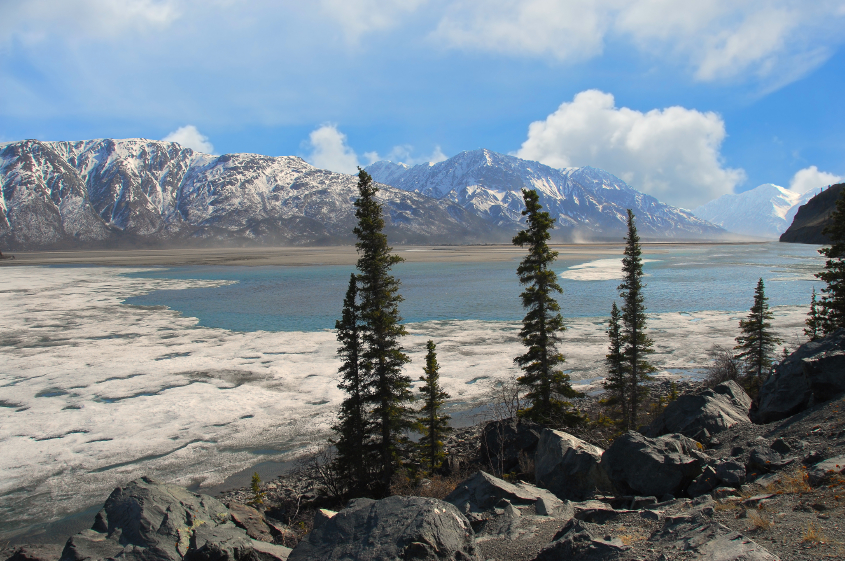 Frozen lake thawing in the Spring in Alaska's Wrangell Mountains. (iStock)