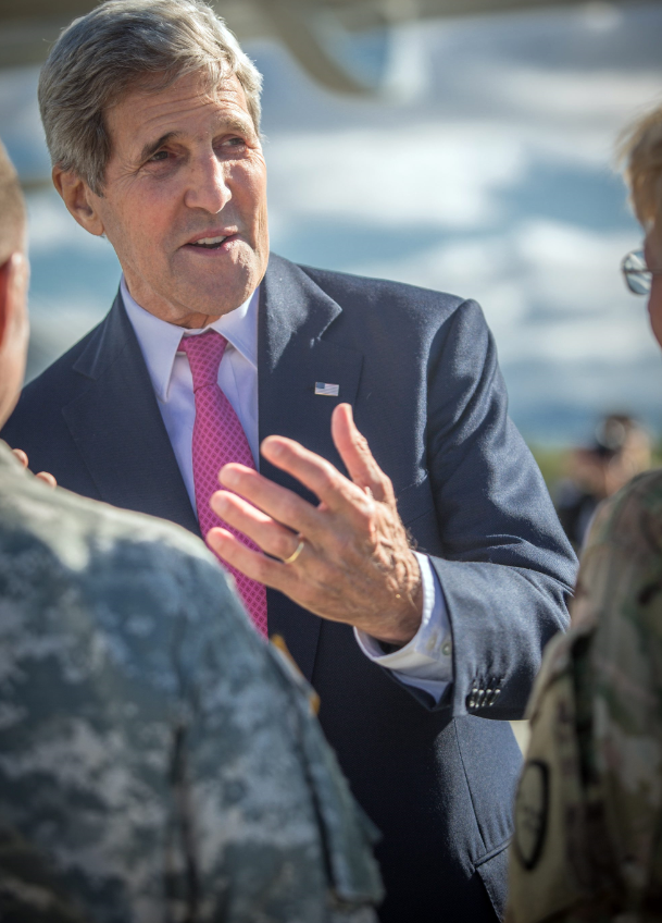 U.S. Secretary of State John Kerry greeting military personnel after landing in Anchorage, Alaska, Sunday, Aug. 30, 2015. (Alaska Governor's Office via AP)