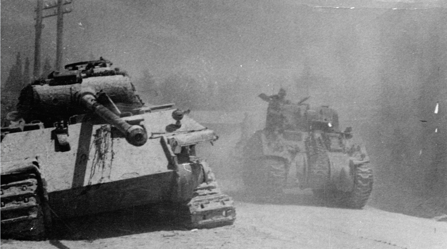 An allied Sherman Tank passing a knocked out German Panther tank during the advance on Arezzo, Italy in July 1944. Sherman tanks are among the relics Russia's Northern Fleet are raising from a sunken WW2 American ship.  (Keystone/Getty Images)