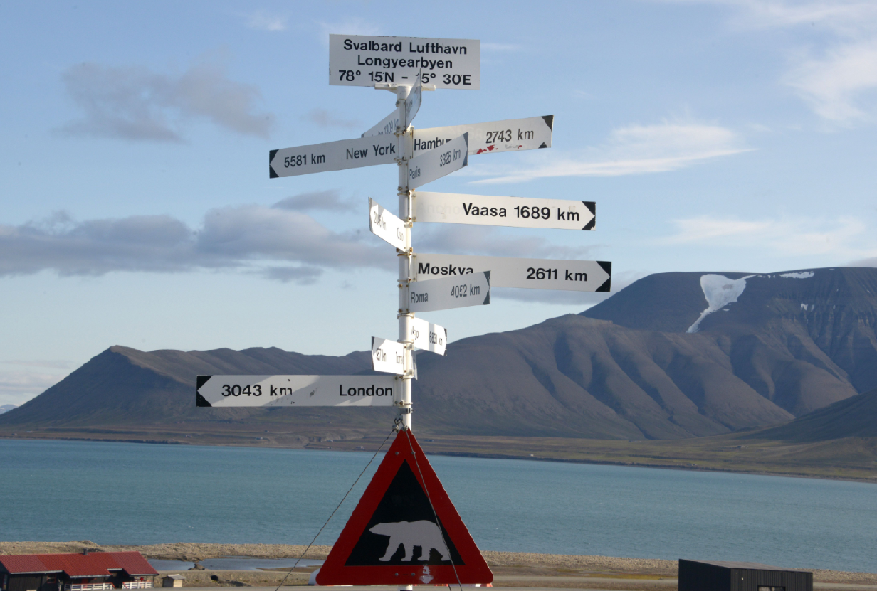 A signpost and a polar bear warning sign at Svalbard's Longyearbyen airport in July 2015.(Dominique Faget/AFP/Getty Images)