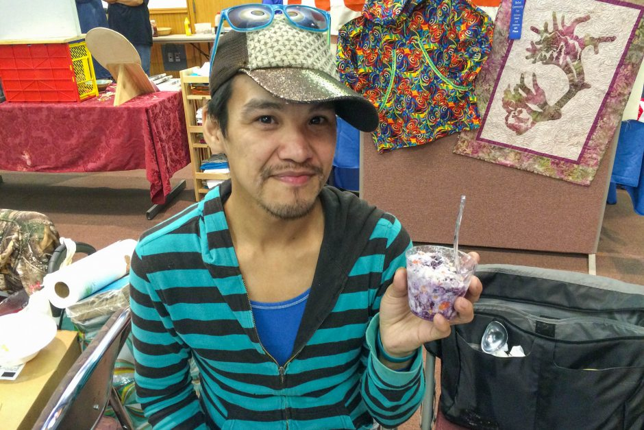 Wassillie Isaac Jr. of Bethel holds up akutaq, or Eskimo ice cream, that he made with whitefish that he netted, along with tundra berries. He wasn't allowed to sell it at Saturday Market in Bethel on July 25, 2015, because the fish wasn't commercially processed. (Lisa Demer / Alaska Dispatch News)